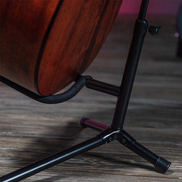 Closeup of acoustic guitar on Stageline stand